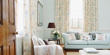 Livingroom setting in bright and neutral colors.