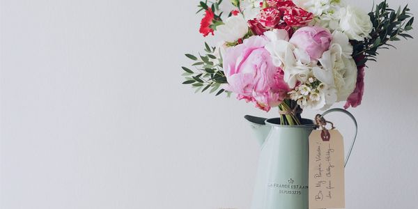 pretty vase of arranged flowers handcrafted