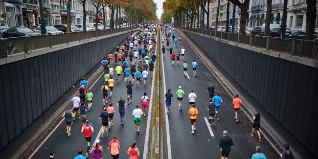 Run with Ben running coaching - run coach blog - marathon runners on a road