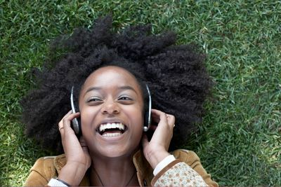 This young African American female seems joyful over the music she hears in the headset.