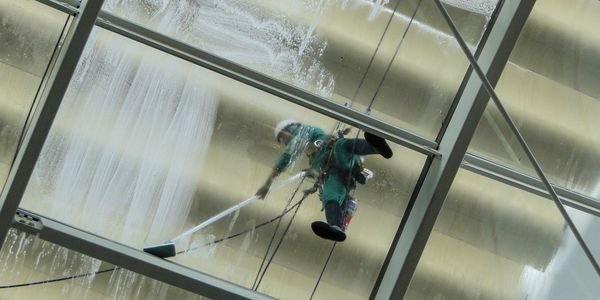 Our employee cleaning commercial windows