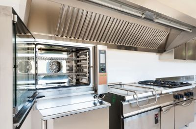 Commercial kitchen and equipment ready to be used before opening its doors to customers. Consultation.