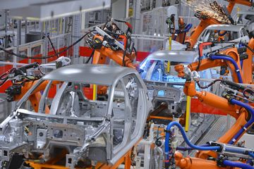 robots robotics in automotive industry, spot welding car assembly line