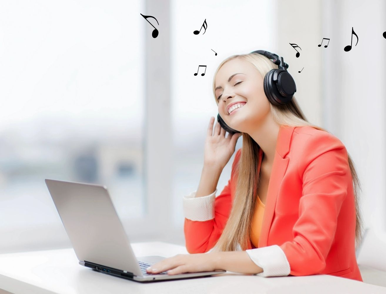 Girl listening to music with headphones.