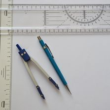 Drawing and measuring equipment laid out on paper