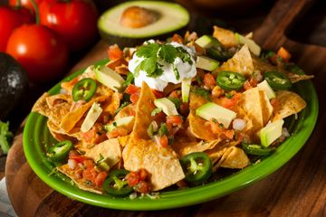 Crunchy nachos covered with cheese blend, onions, tomatoes, peppers, black olives and jalapenos.