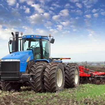 New Holland 4x4 tractor with disc plow
