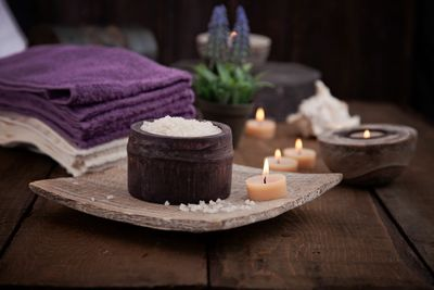 Calming photo with lit candles and towels