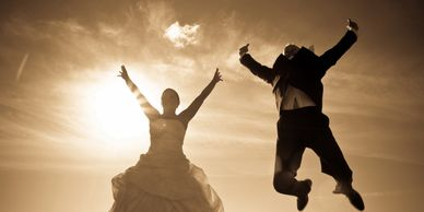 Couple jumping for joy