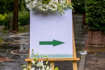 wedding rehearsal sign pointing directions