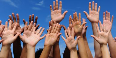 Volunteer Picture with Hands Raised