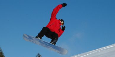 Snowboarder flying through the air.