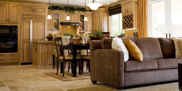 Brown couch and light brown kitchen