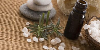 Essential oil and lava rocks with herbs.