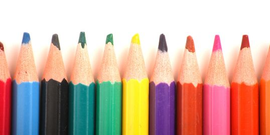 A picture of rainbow colored pencils