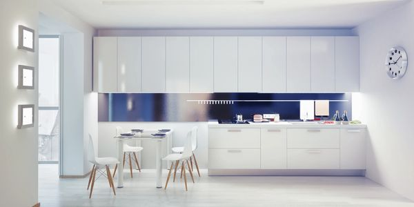modern European white kitchen cabinets with light grey floor and quartz counter top