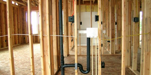 Heartland Irrigation & Landscaping installing plumbing in a new home and commercial construction