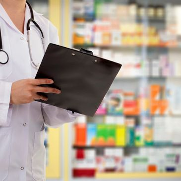 drug store, pharmacist helping, offering immunization, medications, reviewing medical records.