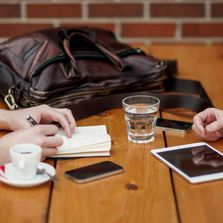 coffee meeting phone and tablet on table