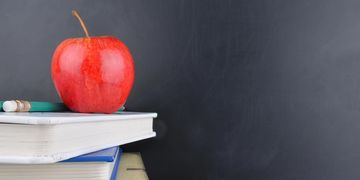 Apple and books in school
