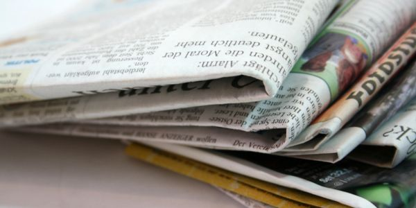 Newspapers stacked on each other