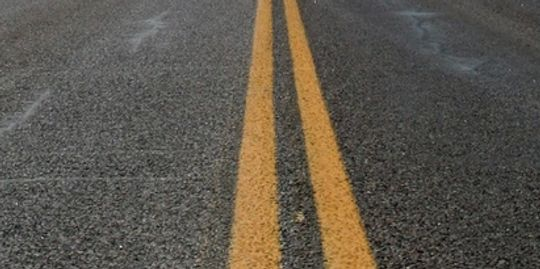 Double Yellow striping to indicate no passing zones in both directions.