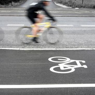 Bicyclist riding in a bicycle lane