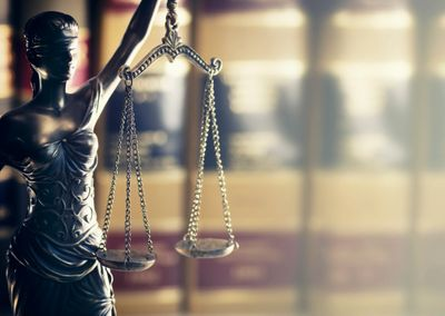 the scales of justice held by lady justice who is blind