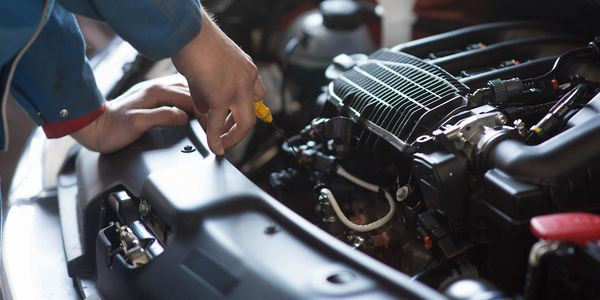 Mechanic fixing engine