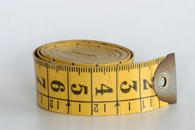 Measuring tape for hand sewing  and machine  alterations on women's dresses, suits, clothes