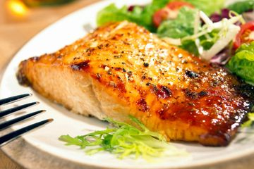 A roasted salmon dish with fresh baked herbs