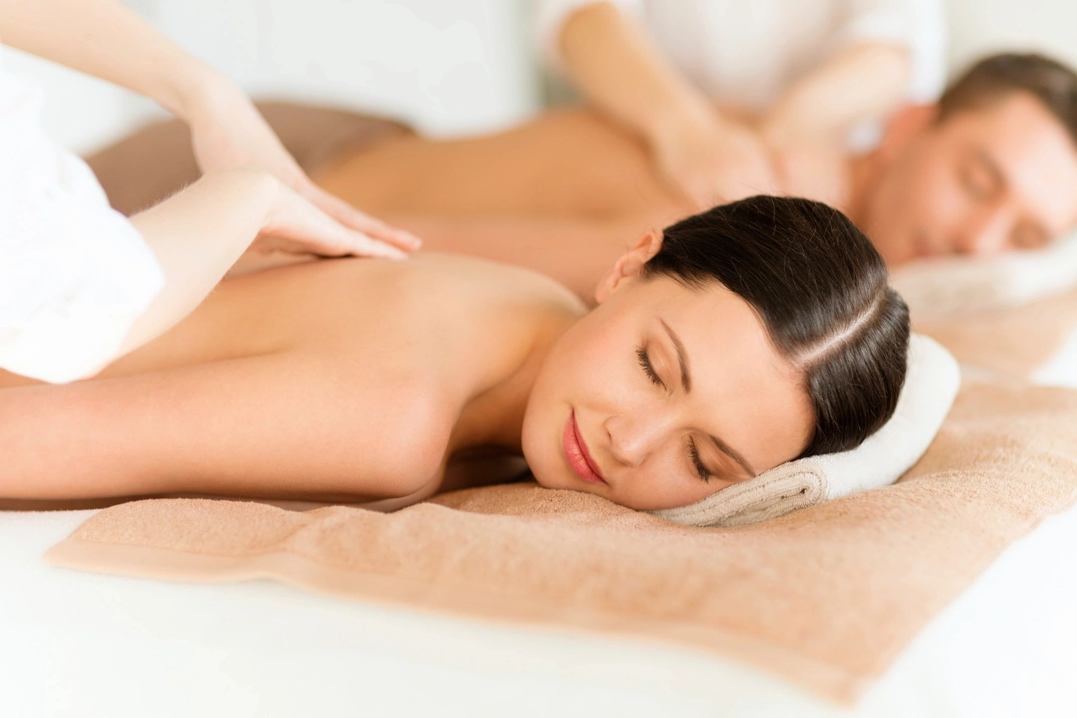 A couple receiving massages at a massage school