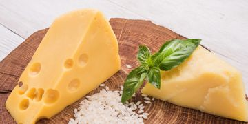 cheddar blocks with basil on a wooden board