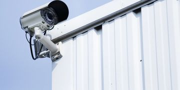 outdoor bullet style camera with infra red zoom lens on a wall