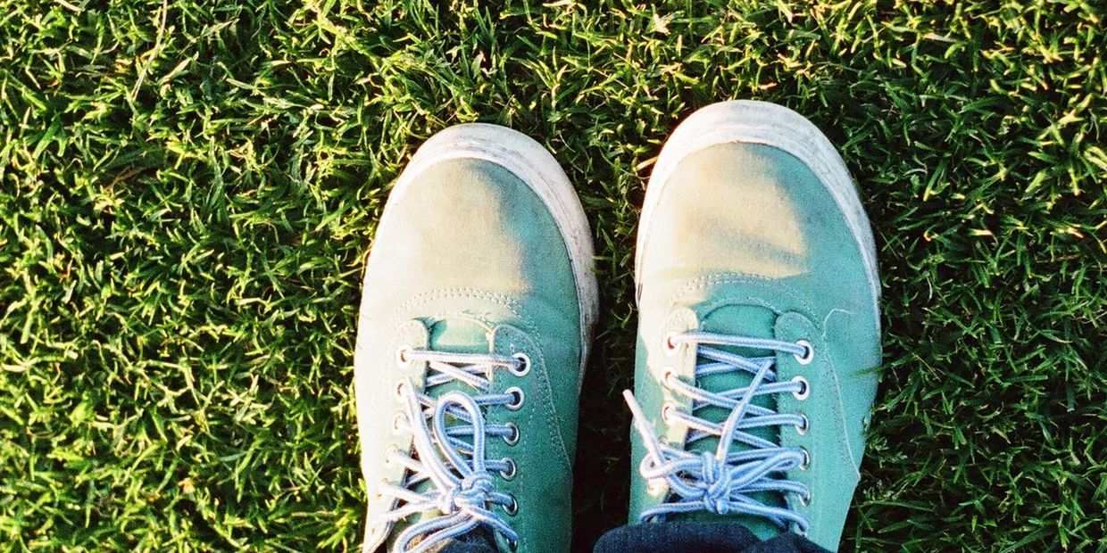 two feet on grass