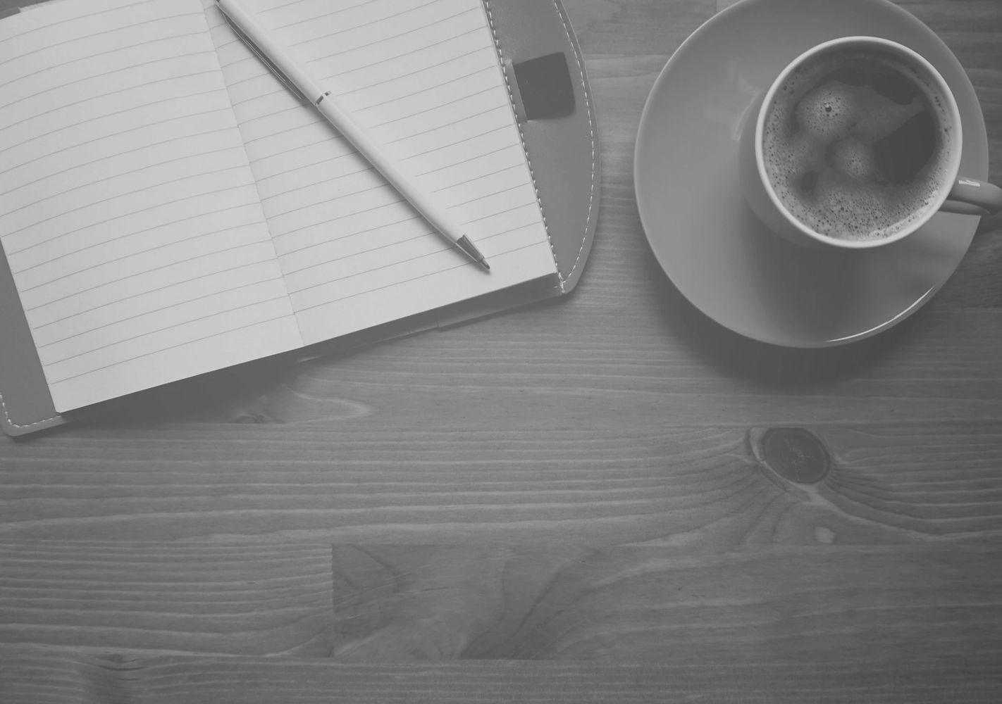Image of a cup of coffee & a note pad, The intention is to express thoughts through written words