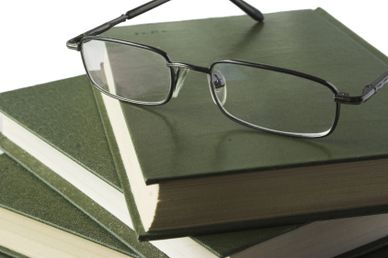 Pair of spectacles on a stack of books.