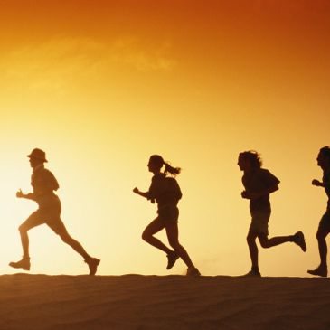 For screen readers - an image of the silhouettes of several individuals jogging