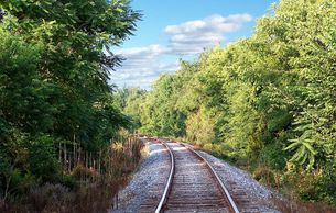 "remote rural heavy secondary railroad tracks; RailHaul provides self-powered, remote operated, autonomous freight cars that could operate on abandoned lines or on newly built ""light"" rail lines with same gauge of rails"