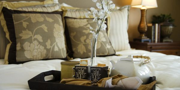 Cushions, soft furnishings and  luxury bed linen available at Sheba Iranian Carpets.