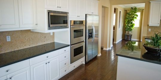 kitchen cabinets painted, appliances and countertops.