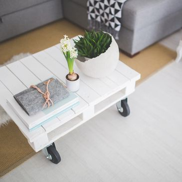White coffee table with decorations in living room