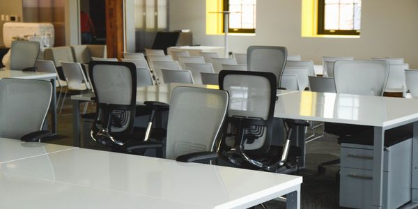 Office desks and chairs in a conference room.