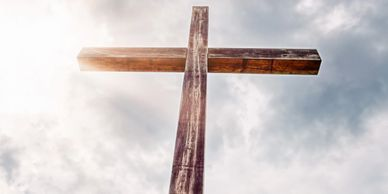 Wooden cross with sky in background