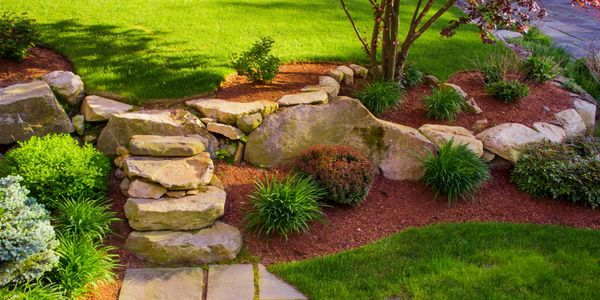 natural stone steps with plantings and mulch