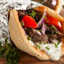 Our  Greek  Gyro  Sandwich   Made From  Lamb  And Beef  With Special Herbs  And Spices. With Fresh C