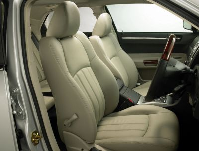 Leather automobile upholstery dyed a light color.