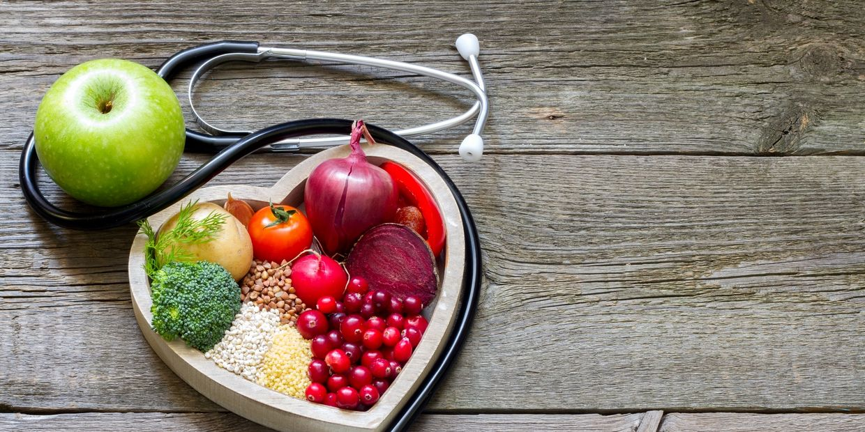 Integrative Medicine.  Heart full of fruit with stethoscope.