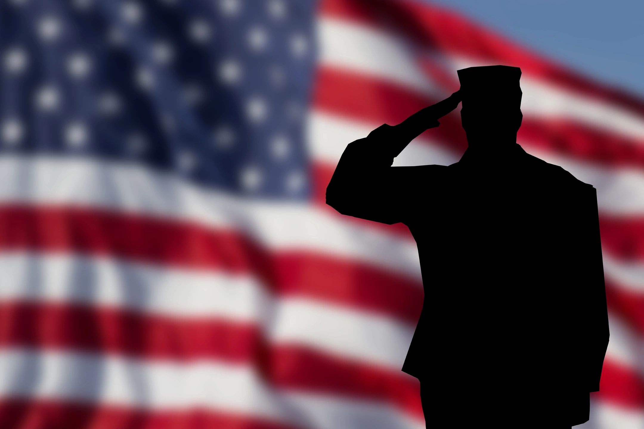 American Flag with Military Service Person