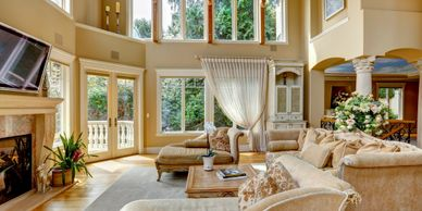 interior photo of a family room with a lot of bayview windows installed